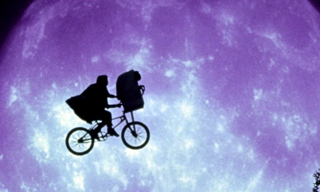 Henry Thomas's Elliott flies high with his other-worldly friend in ET: The Extra-Terrestrial. Photograph: Everett Collection/Rex